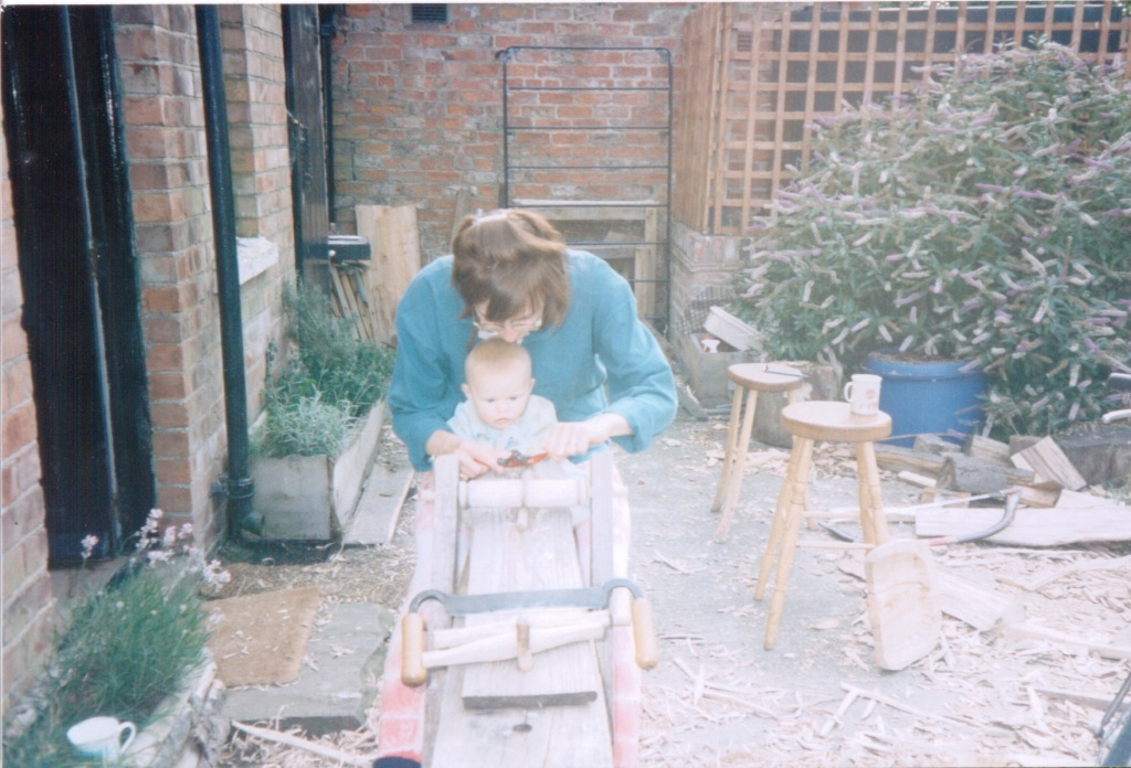 JoJo Wood aged 4 months on shave horse with Nicola Wood