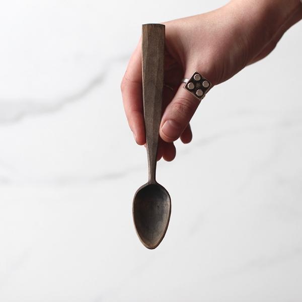 Long handled blue teaspoon