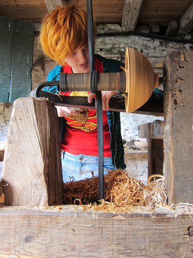 JoJo Wood, aged 17, turning a wooden bowl on a pole lathe