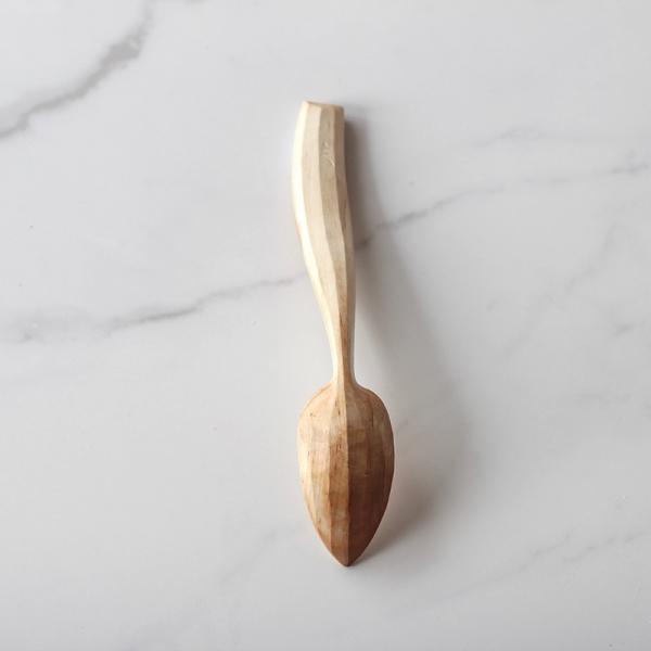 Curvy handled spoon