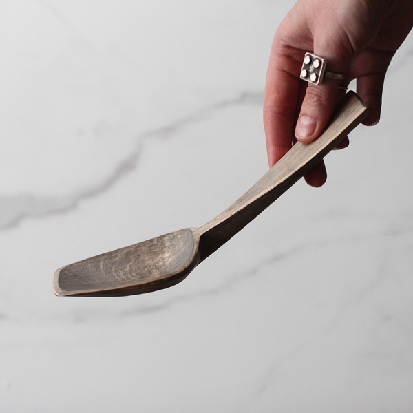 Blue bent branch spoon